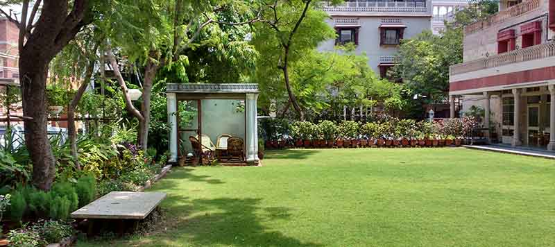 Arya Niwas Front garden with smoking cabin